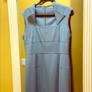 Blue semi fitted sleeveless dress with detail